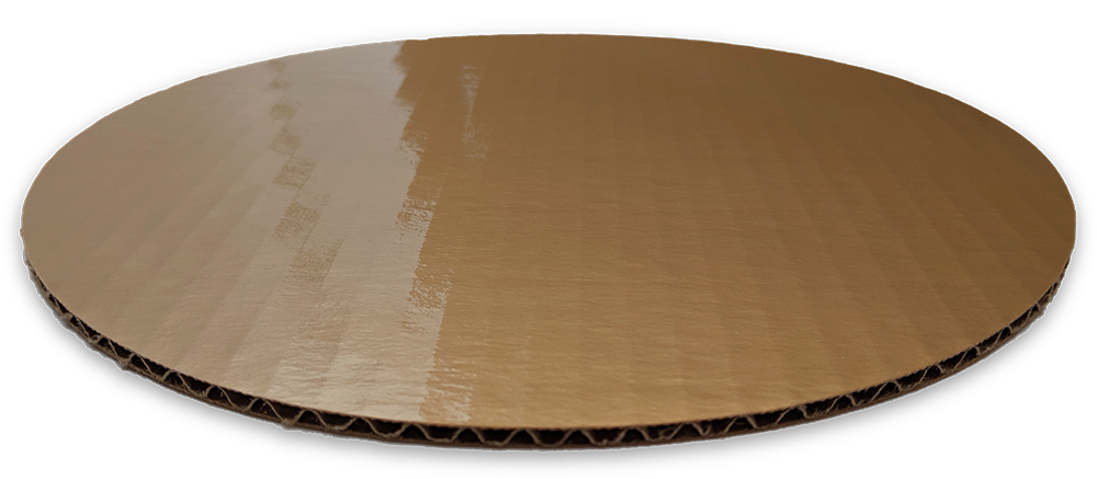 Closeup of a single wall gold cake circle with non-detect PET and smooth edge.